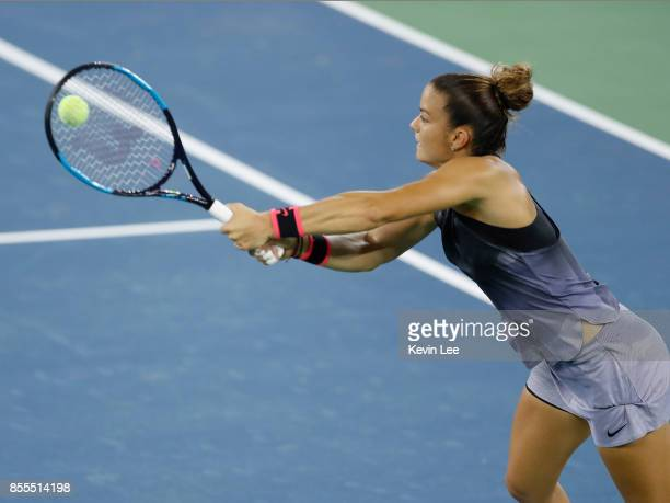 Maria Sakkari of Greece returns a shot to Caroline Garcia of France in their SemiFinal match of Women's Single at 2017 Wuhan Open on September 29...