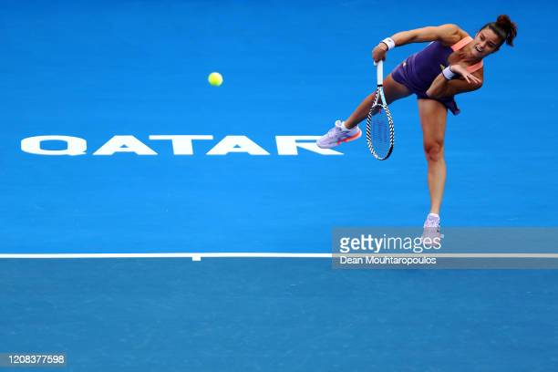 Maria Sakkari of Greece serves against Julia Goerges of Germany during Day 2 of the WTA Qatar Total Open 2020 at Khalifa International Tennis and...