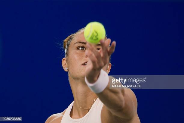 TOPSHOT Maria Sakkari of Greece serves against Wang Qiang of China during their women's singles second round match of the WTA Wuhan Open tennis...