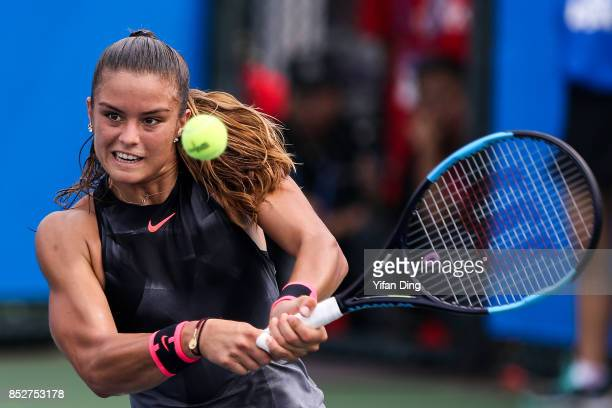 Maria Sakkari plays a backhand against Yulia Putintseva on Day 1 of 2017 Dongfeng Motor Wuhan Open at Optics Valley International Tennis Center on...