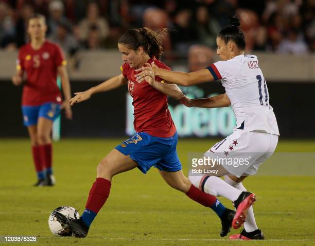 Maria Salas of Costa Rica is pressured by Ali Krieger of United States during a Group A 2020 CONCACAF Women's Olympic Qualifying match at BBVA...