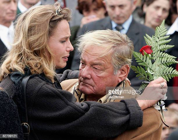Maria Schell's brother Carl Schell right and her daughter Marie Theres KroetzRelin left attend the funeral of actress Maria Schell at the Nikolaus...