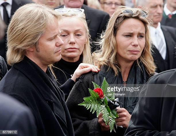 Maria Schell's son Oliver Schell left her daughter Marie Theres KroetzRelin right and her sister in law Natascha Schell center attend the funeral of...