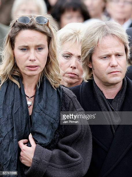 Maria Schell's son Oliver Schell right and her daughter Marie Theres KroetzRelin left attend the funeral of actress Maria Schell at the Nikolaus...
