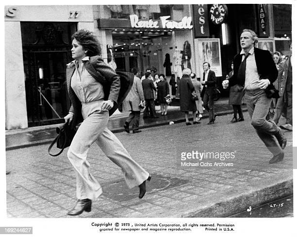 Maria Schneider is chased by Marlon Brando in a scene from the film 'Last Tango In Paris' 1972