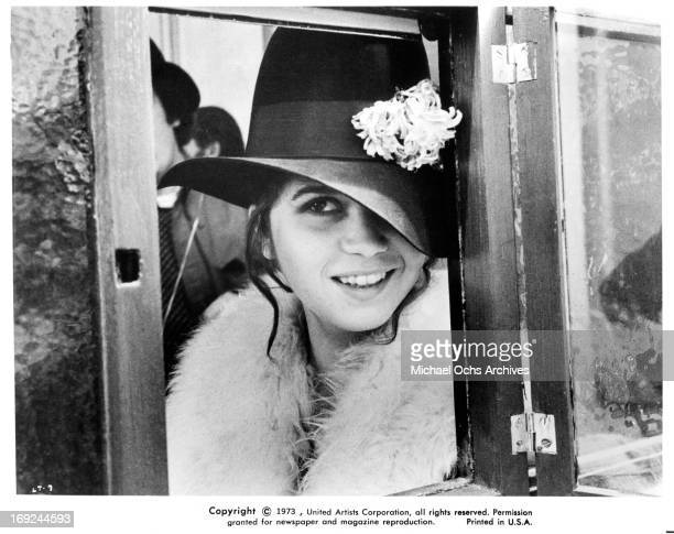 Maria Schneider stands in a telephone booth in a scene from the film 'Last Tango In Paris' 1972