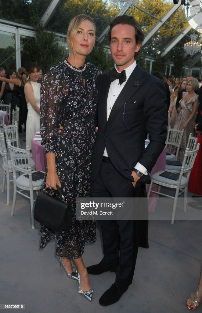 Maria Sharapova (L) and Alexander Gilkes attend the Argento Ball for the Elton John AIDS Foundation in association with BVLGARI & Bob and Tamar Manoukian on June 27, 2018 in Windsor, England.