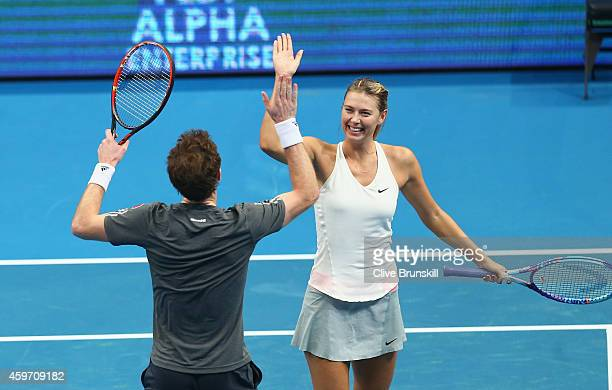 Maria Sharapova and Andy Murray of the Manila Mavericks celebrate winning a game in their match against Rohan Bopanna and Sania Mirza of the Indian...