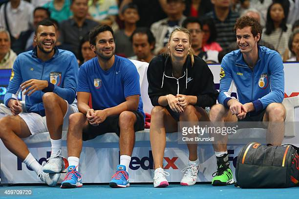 Maria Sharapova and Andy Murray of the Manila Mavericks share a joke whilst sitting on the team bench watching their team mates play the Indian Aces...