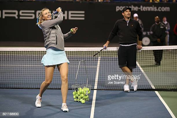 Maria Sharapova and Andy Roddick hit balls into the crowd at the Maria Sharapova and Friends tennis exhibition Presented By Porsche on December 12...