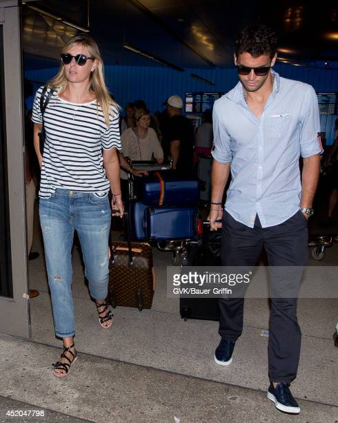 Maria Sharapova and Grigor Dimitrov seen at LAX on July 11 2014 in Los Angeles California