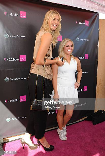 Maria Sharapova and LookALike winner at the launch of the Sony Ericsson Equinox Phone at the TMobile Store on October 31 2009 in Canoga Park...