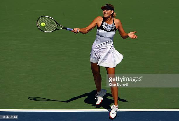 Maria Sharapova hits a return shot against Agnieszka Radwanska of Poland during day six of the 2007 US Open at the Billie Jean King National Tennis...