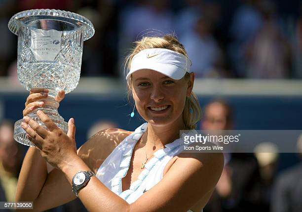 Maria Sharapova holding up her trophy after her 76 63 finals victory at The Bausch Lomb Championships held at Amelia Island Plantation in Amelia...
