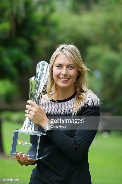 Maria Sharapova holds the Evonne Goolagong Cawley trophy at the Brisbane Botanic Gardens after winning the Womens 2015 Brisbane International on...