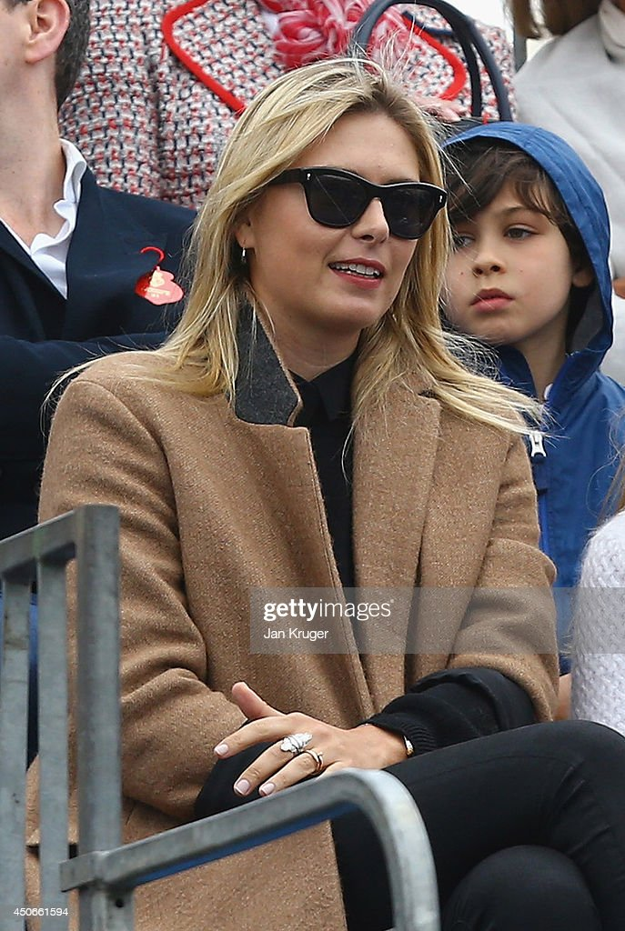 Maria Sharapova is seen wearing a ring on her wedding ring finger as she watches the match between her boyfriend Grigor Dimitrov of Bulgaria and Feliciano Lopez of Spain during their Men's Singles Final on day seven of the Aegon Championships at Queens Club on June 15, 2014 in London, England.