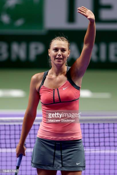 Maria Sharapova of Russia acknowledges the crowd after her win over Sara Errani of Italy in round robin play during the TEB BNP Paribas WTA...