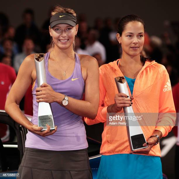 Maria Sharapova of Russia and Ana Ivanovic of Serbia pose with their trophys after the final against on day seven of the Porsche Tennis Grand Prix...