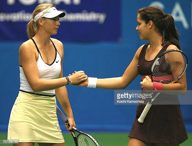 Maria Sharapova of Russia and Ana Ivanovic of Serbia shake hands during the semifinal women's singles at the Toray Pan Pacific Tournament at the...
