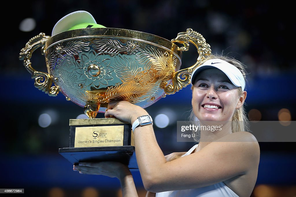 Maria Sharapova of Russia (Right) and Petra Kvitova of Czech Republic (Left) pose with their trophies during the medal ceremony after the Women's Single Final on day nine of the China Open at the China National Tennis Center on October 5, 2014 in Beijing, China.