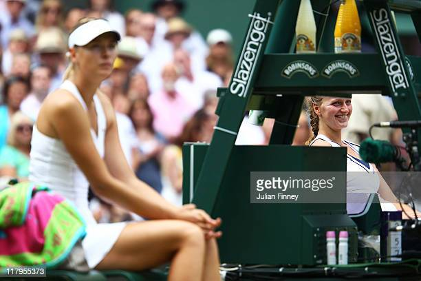 Maria Sharapova of Russia and Petra Kvitova of the Czech Republic react after their Ladies' final round match on Day Twelve of the Wimbledon Lawn...