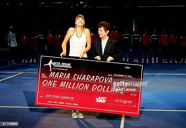 Maria Sharapova of Russia and tennis legend Billie Jean King pose with the million dollar check after Sharapova defeated Serena Williams in the...