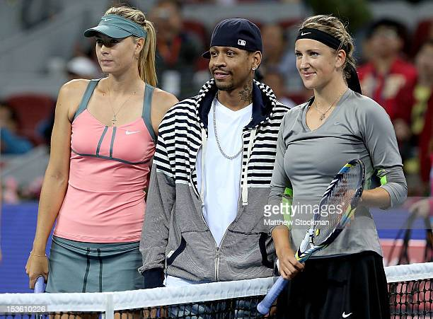 Maria Sharapova of Russia and Victoria Azarenka of Belarus pose pose at the net before their match with NBA player Allen Iverson during the final of...