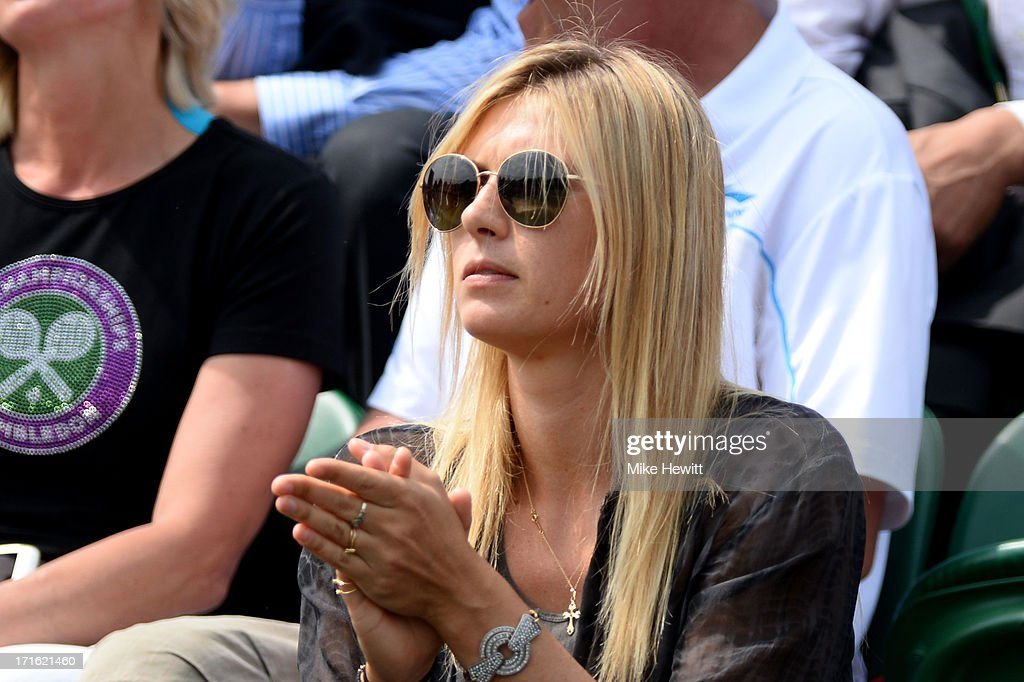 Maria Sharapova of Russia applauds during the Gentlemen's Singles second round match between Grigor Dimitrov of Bulgaria and Grega Zemlja of Slovenia on day four of the Wimbledon Lawn Tennis Championships at the All England Lawn Tennis and Croquet Club on June 27, 2013 in London, England.