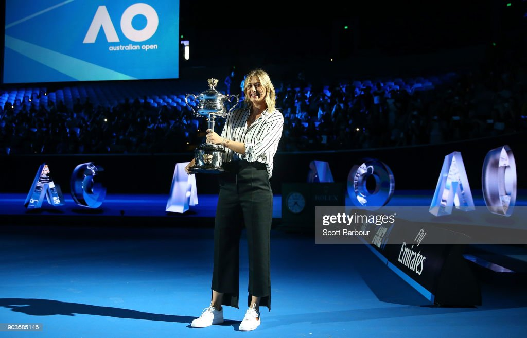 Maria Sharapova of Russia arrives on court with the the Daphne Akhurst Trophy during the 2018 Australian Open Official Draw at Melbourne Park on January 11, 2018 in Melbourne, Australia.