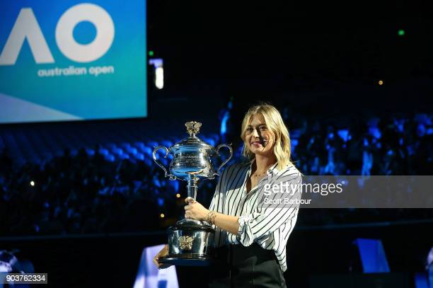 Maria Sharapova of Russia arrives on court with the the Daphne Akhurst Trophy during the 2018 Australian Open Official Draw at Melbourne Park on...