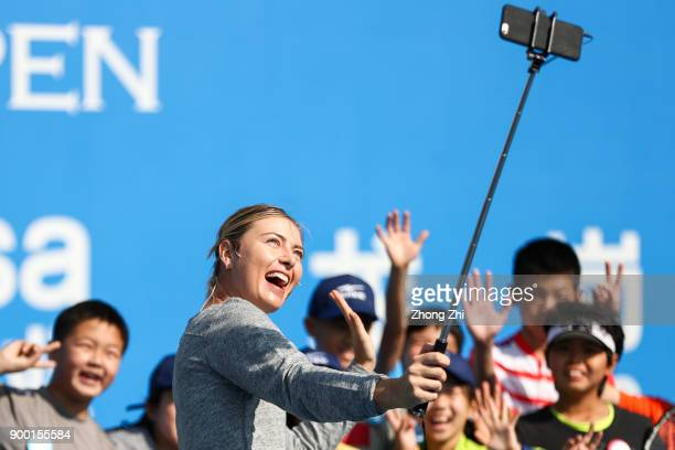 Maria Sharapova of Russia attends Kids Day and takes selfie with kids during Day 1 of 2018 WTA Shenzhen Open at Longgang International Tennis Center...