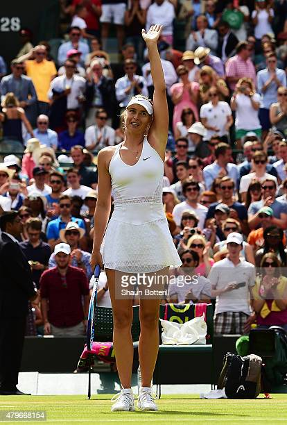 Maria Sharapova of Russia awaves to the crowd after victory in her Ladies' Singles Fourth Round match against Zarina Diyas of Kazakhstan during day...