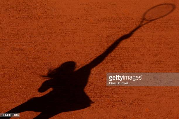 Maria Sharapova of Russia casts a shadow as she serves during the women's singles round three match between Maria Sharapova of Russia and YungJan...