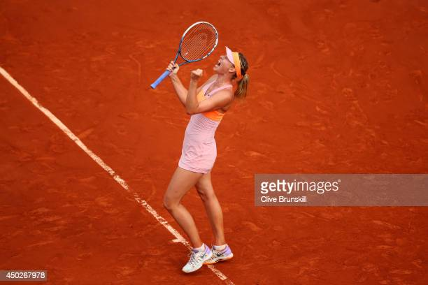 Maria Sharapova of Russia celebrates a point during her women's singles final match against Simona Halep of Romania on day fourteen of the French...
