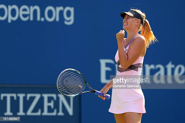 Maria Sharapova of Russia celebrates a point during her women's singles semifinal match against Victoria Azarenka of Belarus on Day Twelve of the...