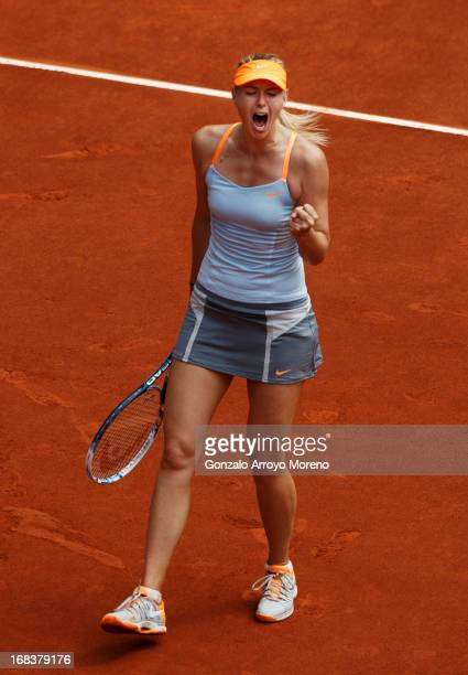 Maria Sharapova of Russia celebrates a point over Sabine Lisicki of Germany on day six of the Mutua Madrid Open tennis tournament at the Caja Magica...