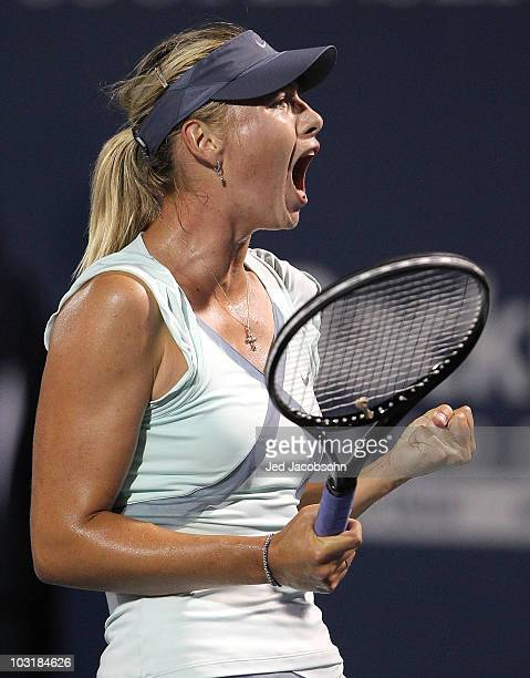 Maria Sharapova of Russia celebrates after defeating Agnieszka Radwanska of Poland during the semifinals of the Bank of the West Classic at Stanford...