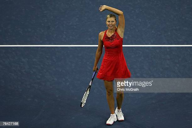 Maria Sharapova of Russia celebrates after defeating Casey Dellacqua of Australia during day four of the 2007 US Open at the Billie Jean King...
