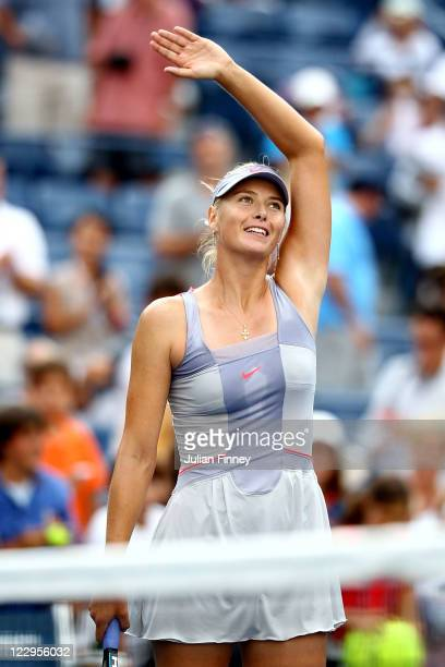 Maria Sharapova of Russia celebrates after defeating Heather Watson of Great Britian during Day One of the 2011 US Open at the USTA Billie Jean King...