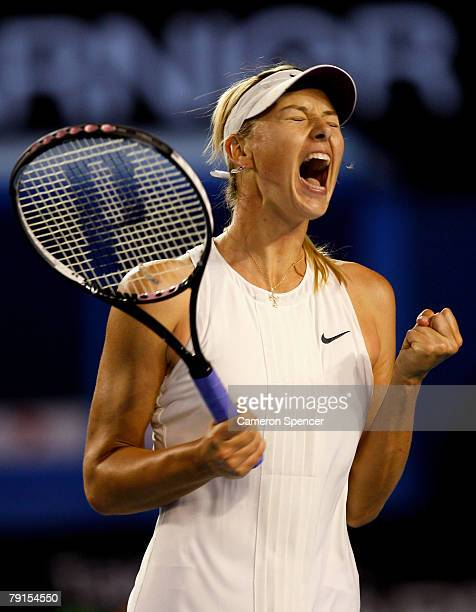 Maria Sharapova of Russia celebrates after winning a point during her quarterfinal match against Justine Henin of Belgium on day nine of the...