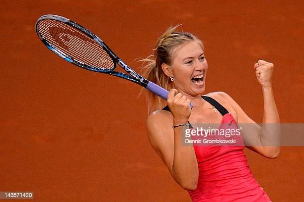 Maria Sharapova of Russia celebrates after winning her final match against Victoria Azarenka of Belarus during day seven of the WTA Porsche Tennis...