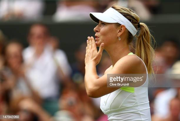 Maria Sharapova of Russia celebrates after winning her Ladies' Singles second round match against Tsvetana Pironkova of Bulgaria on day four of the...
