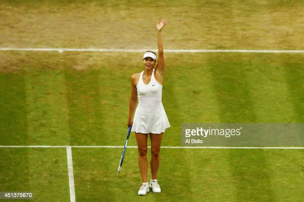Maria Sharapova of Russia celebrates after winning her Ladies' Singles third round match against Alison Riske of the United States on day six of the...