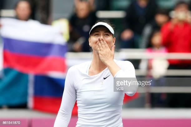 Maria Sharapova of Russia celebrates after winning the women's singles final match against Aryna Sabalenka of Belarus at the WTA Tianjin Open tennis...