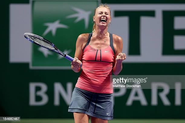 Maria Sharapova of Russia celebrates breaking Agnieszka Radwanska of Poland late in the third set in round robin play during the TEB BNP Paribas WTA...
