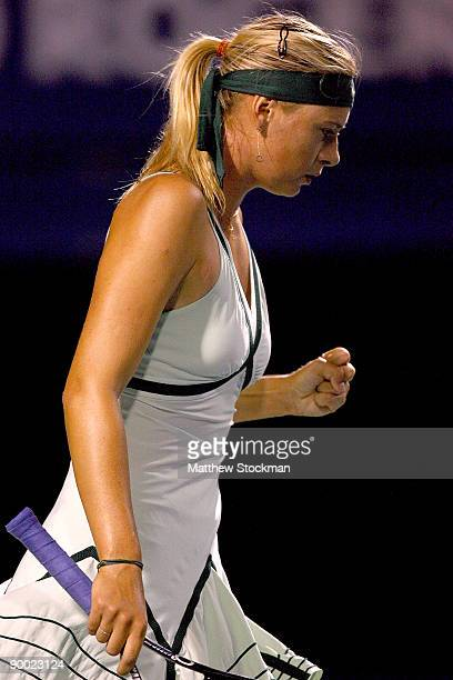 Maria Sharapova of Russia celebrates breaking Alisa Kleybanova of Russia in the first set during the semifinals of the Rogers Cup at the Rexall...