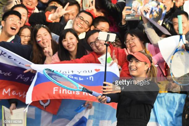 Maria Sharapova of Russia celebrates by taking a selfie with fans after winning against Timea Bacsinszky of Switzerland during the women's singles...