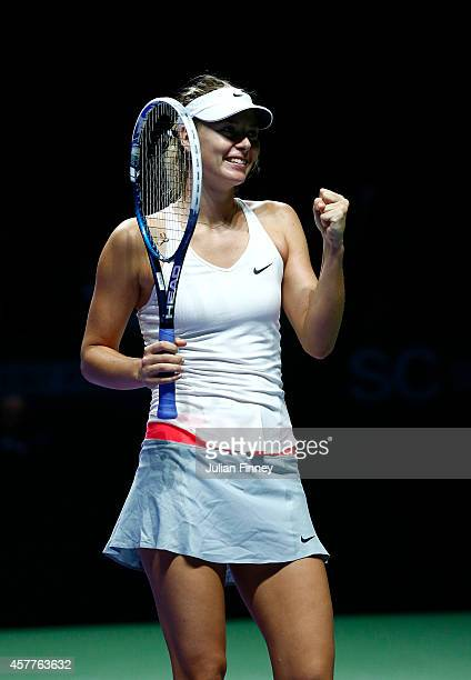Maria Sharapova of Russia celebrates defeating Agnieszka Radwanska of Poland during day five of the BNP Paribas WTA Finals tennis at the Singapore...