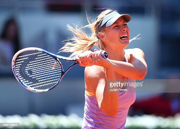 Maria Sharapova of Russia celebrates defeating Klara Koukalova of Czech Republic during day two of the Mutua Madrid Open tennis tournament at the...