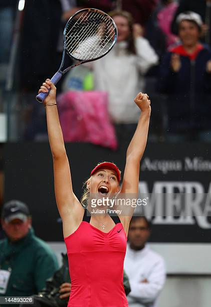 Maria Sharapova of Russia celebrates defeating Na Li of China during their final match during day nine of the Internazionali BNL d'Italia 2012 at the...